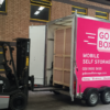 A Forklift Truck unloads a Storage Pod from the Go Box Trailer